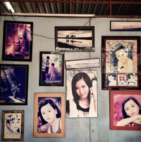 "David Guttenfelder, ""Prints hang in the wall at a photo studio in a Vietnamese village. When I'm traveling, new to a place and want to know what's going on, I like to go see the local photo lab owner and meet the photographers who hang around there."", 2014"
