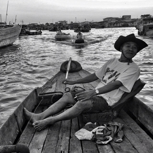"David Guttenfelder, ""My great friend / photo mentor Ricardo Mazalan once told me ""Don't pick your driver by his car. Pick your driver by his character."" I guess the same is true for men and boats. I'll be spending the next couple of days with this cool character here in Can Tho, Vietnam."", 2014"