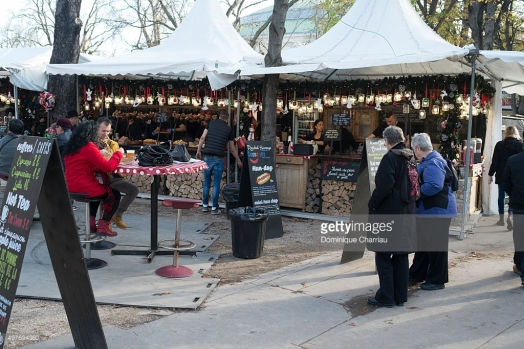 D. Charriau, People visit the reopened Christmas market on Champs Elysees on November 18, 2015 in Paris, France. The Christmas market was closed by Police after the deadly terrorist attacks