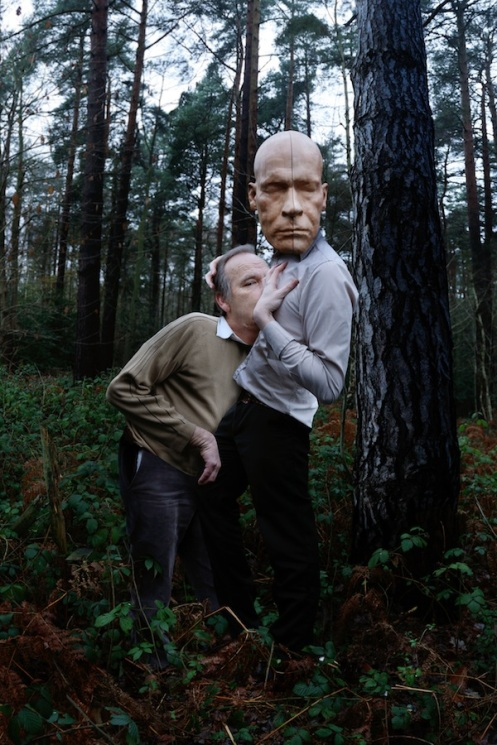 "J. Briggs, ""Reclaiming, 2011 --- Father and self wearing wooden mask of Father's head"""